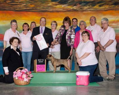 "2014 Best In Show winner shown with CIKC members and Senator Chapin Rose (back row) who presented the Best In Show ribbon.  This was our 4th ""Purebreds In The Pink"" Cancer Awareness Show."